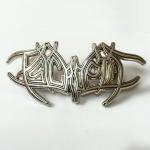 Metal logo pin